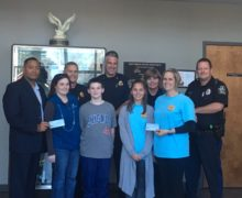 SCOTTSBORO POLICE RAISE $6,200.00 DOLLARS FOR CHILDHOOD CANCER FUND